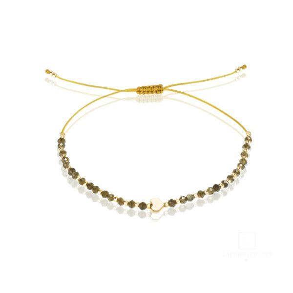 Bransoletka na cienkim musztardowym sznureczku przeplatana naturalnymi, ciemnymi obsydianami oraz srebrem 925.