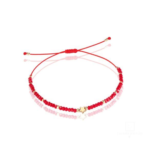 Bransoletka na cienkim sznurku z błyszczącymi kryształkami czerwona